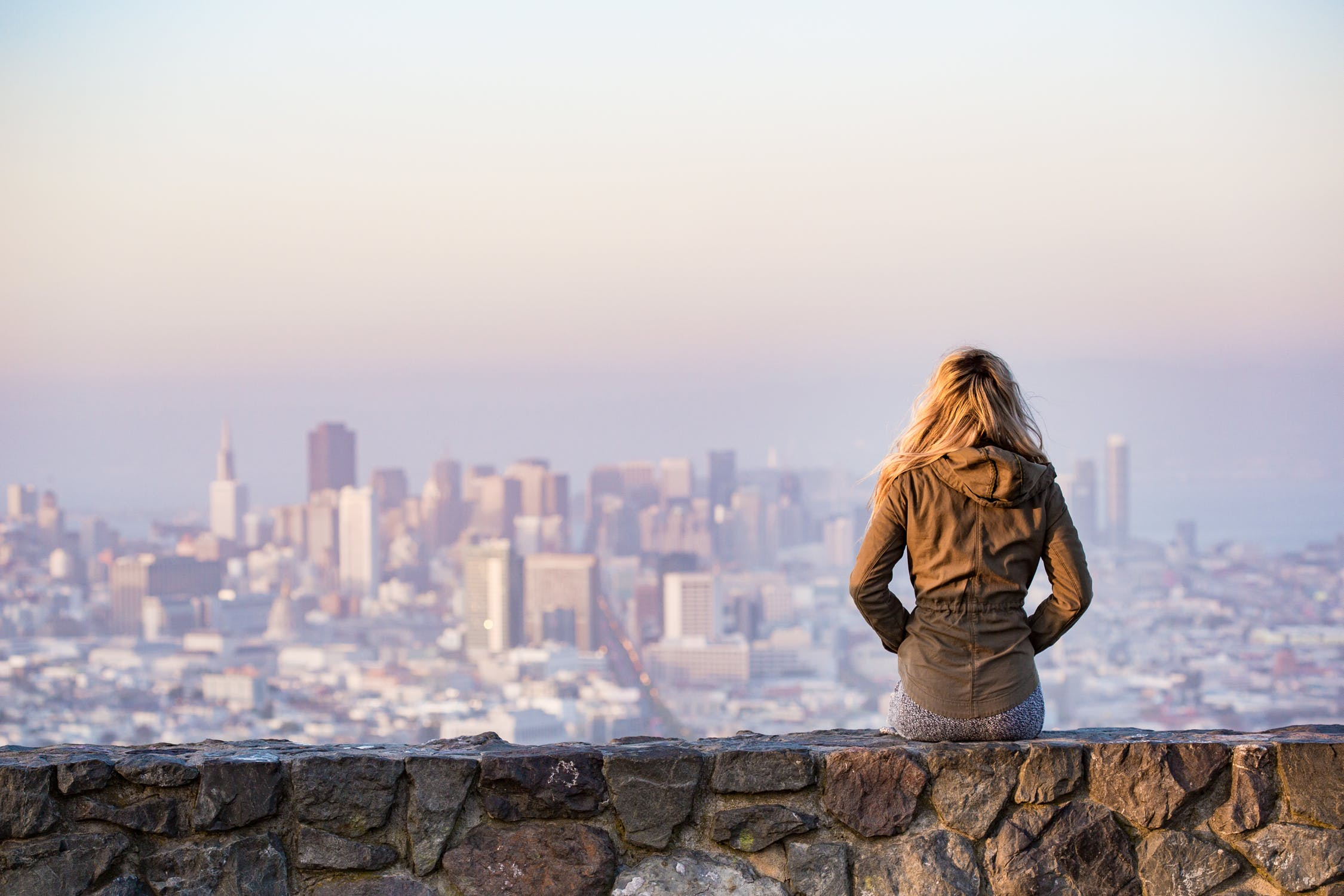 Girl Looking At Skyline Of City
